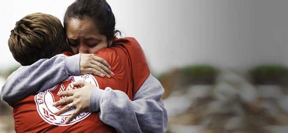 a salvation army disaster services worker embraces a survivor