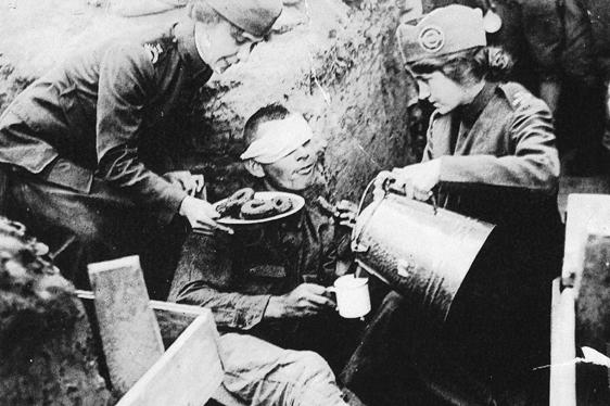Salvationist giving doughnuts to the wounded at war