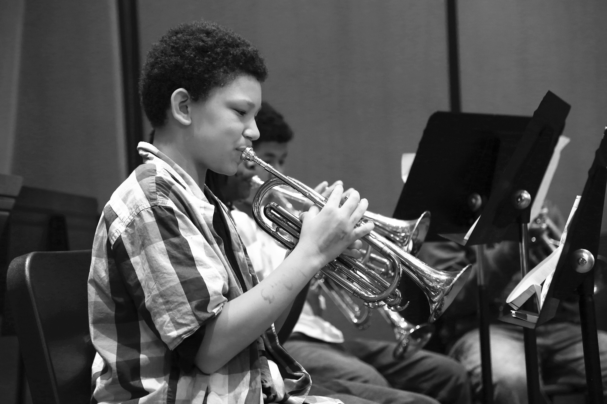 Photo of young boy playing cornet at The Salvation Army school for Music and Arts